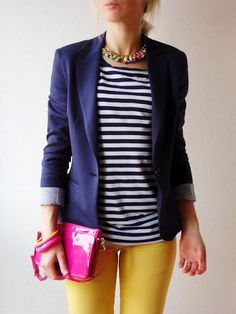 Step up you off-duty look in a navy blazer and yellow skinny jeans.  Shop this look for $75:  http://lookastic.com/women/looks/necklace-crew-neck-t-shirt-blazer-bracelet-clutch-skinny-jeans/4508  — Multi colored Necklace  — Navy and White Crew-neck T-shirt  — Navy Blazer  — Neon Pink Statement Bracelet  — Neon Pink Leather Clutch  — Yellow Skinny Jeans