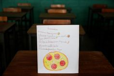 "A drawing made during a lesson at a school shows what a student ate during the course of a day in Caracas, Venezuela. The student wrote, ""Ate corn cake with cheese for breakfast; had spaghetti with egg for lunch and a cookie for dinner."" The student said that pizza was their favorite dish. REUTERS/Carlos Jasso"