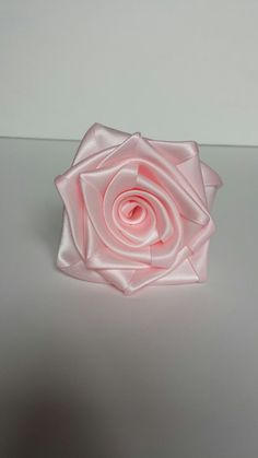 Check out this item in my Etsy shop https://www.etsy.com/ca/listing/251864880/6-pink-rolled-ribbon-satin-roses-diy