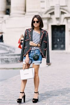 Vanessa Jackman: Paris Couture Fashion Week AW 2013  Miroslava Duma makes denim shorts chic by pairing it with a tweed jacket