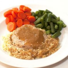 Seasoned Pork Loin with Gravy, Yellow Rice, Green Beans and Carrots | DineWise