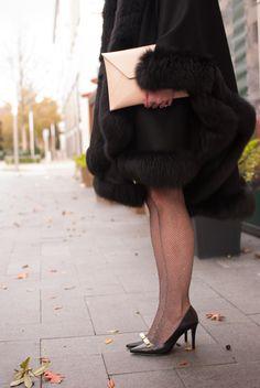 Metallic fishnet tights and black heels