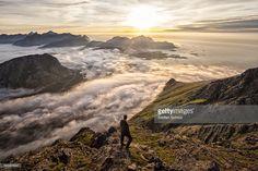 Foto de stock : Man above the clouds on mountain Lofoten Norway
