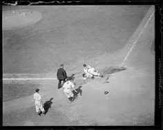 1937 - Unknown New York Yankee player slides into home plate in front of Boston Red Sox catcher Gene Desautels (#23). New York Yankee Lou Gehrig (#4), unknown umpire, and batboy look on.