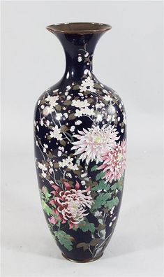 A large Japanese cloisonne enamel ovoid vase, Meiji period, decorated with chrysanthemums and prunus trees on a midnight blue ground, 35.25in