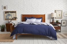 medium-height bed; navy bedding; medium wood