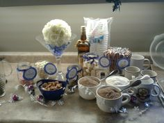 Hot chocolate bar at my sister's winter theme wedding shower. Candy sticks as stir sticks and lots of fun toppings
