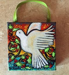 Title: Dove and Holly  One 4 x 4 Canvas Ornament with ribbon  Sides painted black, Ready to Hang  Card stock backing (not necessarily the same color
