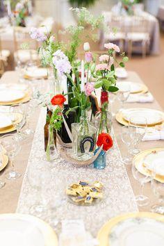 eclectic rustic tablescape, photo by Ben Sasso http://ruffledblog.com/sweet-santa-fe-river-ranch-wedding #centerpieces #tablescape #wedding
