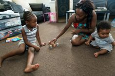 Aneisha Newell, playing with daughter Alona Sharp and son Amod Newell, uses fewer directives with her children since participating in the Th...