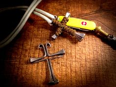 I made this Horseshoe Nail Cross Pendant with Steel 2 inch Horseshoe Nails and some Coyote Tan 1.18mm micro cord.