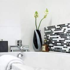 Create a bright backdrop in your kitchen or bathroom with the introduction of these Gloss White Wall Tiles. Rectangular in shape, they have a polished finish that gleams and shimmers under the light. White Wall Tiles, House Tiles, Under The Lights, Underfloor Heating, Kitchen Tiles, Bathroom Wall, Bathroom Inspiration, Backdrops, Flooring