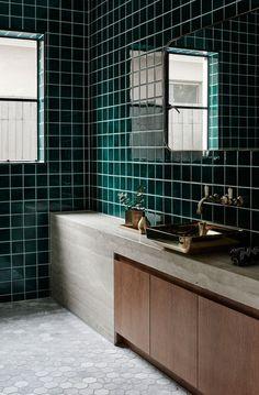 Deep green, concrete, dark wood and brass.
