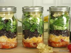 Taco salad with peach salsa dressing in mason jars and tips for packing any salad.