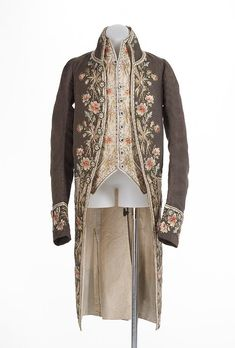 Coat and waistcoat, France, c. 1775. Brownn figured silk, lavishely embroidered with naturalistic floral motifs; waistcoat: cream silk satin with matching embroidery, embroidered buttons, linen lining.