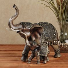 Performance elephants | Home Nurturing Elephant Sculpture Brown