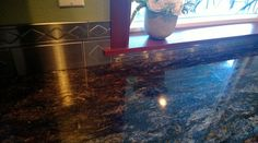 customer photo- stainless steel decor and boarder tiles create a beautiful modern look- kitchen remodel