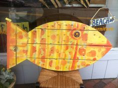Made from recycled wood, yellow and orange spotted fish. This one swam home.