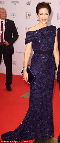 Denmark's Crown Princess Mary in an elegantly simple sequined evening dress in midnight blue.