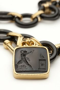 Beautiful black Venetian glass intaglio pendant set in 19kt yellow gold.  Pendant features the Goddess at the alter.Please note that the necklace shown here is sold separately