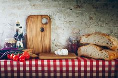 Cutting Board Set. Olive solid wood. Objects for the table that contain the strength of a big tree. Monolithic objects, where time has left its fascinating signs over the centuries. Open flame finished edges enhance the design of cracks and chinks.