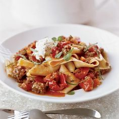 Pappardelle with Lamb Ragù | Andrew Carmellini serves fresh pappardelle with a ragù of house-ground lamb shoulder cooked in lamb stock. He finishes the dish with fresh ricotta and chopped mint. To simplify the recipe, use store-bought pappardelle, ground lamb and chicken stock, then top the dish with fresh ricotta and mint.