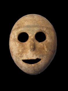 This stone mask from the pre-ceramic neolithic period dates to 7000 BC and is probably the oldest mask in the world (Musée de la Bible et de la Terre Sainte)