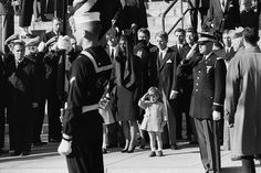 John Kennedy Jr., age 3, salutes as his father's casket is carried from St. Matthew's Cathedral, Washington, DC; November 25, 1963