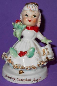Vintage January Carnation Angel Holding Ice Skates & Bouquet of Flowers TMJ