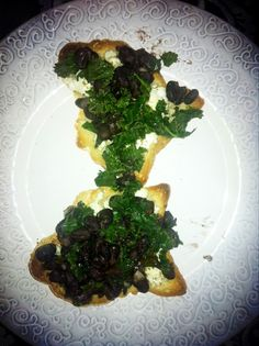 Black Bean and Kale on Gluten free crostini with herbed goat cheese and chipotle infused olive oil