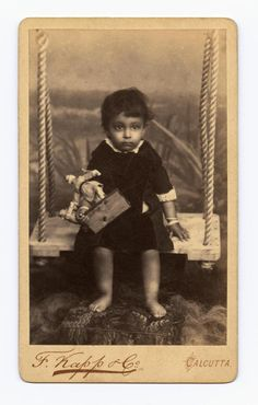 Unidentified child on a swing. F Knapp & Co. Calcutta