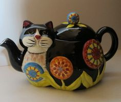 """Collectable Adorable Roscher """"Penny Lane"""" Chesire Cat Kitten Tea Pot  This is an adorable collectable Roscher tea pot of a black & white cat decorated with multi colored flowers. It measures 9.5"""" wide, 5"""" tall and 5.5"""" wide. It is in great condition. There is one flaw original to the piece which is a white spot on the front top of the lid (picture # 8)."""