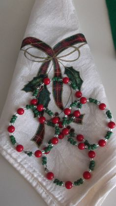 Christmas red green clear glass bead memory wire napkin rings set. $5.00, via Etsy.