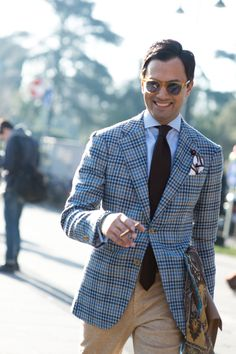 """Blue check jacket and camel trousers, its the accessories that make, that amazing scarf in mustard and brown with turquoise. """"Street style from Pitti Uomo A/W '15 - GQ.co.uk"""""""