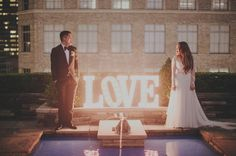 This LOVE wedding marquee is fabulous for an urban wedding | Photo by Sean Flanigan via june.bg/1pIt125