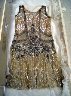 Evening dress Date: 1926 Culture: American Medium: cotton, sequins, beads Dimensions: Length at CF: 42 in. (106.7 cm) Credit Line: Gift of M...