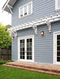 trellis on side of house echoing triangular gable support