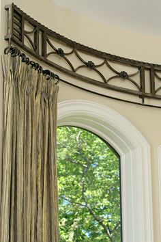 110056784617798255 Curved curtain rod window detail