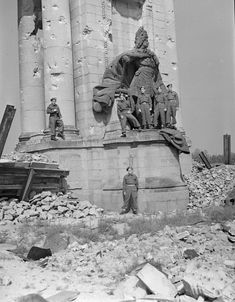 Berlin, 1945: Infantrymen of Les Fusiliers Mont-Royal in front of a statue of Frederick the Great, Berlin, Germany, 14 July 1945.