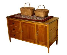 """Shaker Furniture - Tailor's counter, pine, natural varnish finish, single-board top, breadboarded pine pull-out work surface, over a central double vertical panel door flanked on left by three graduated, lipped and nailed drawers with walnut turned pulls, (ex. Balwin Family, Bridgewater, NH, early collectors of Enfield and Canterbury, NH, featured on """"Find"""" television program).  $13,000"""