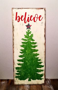Believe Rustic wood Christmas sign is painted cream with green tree and paper plaid star. Lettering is deep red. Distressed and sealed. SIZE: approximately 23.5 x 9.5 I ship USPS.