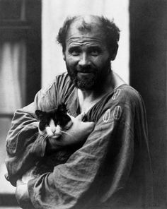 Gustav Klimt holding one of his cats, in front of his Viennese studio at Josefstaedter Strasse, 1912