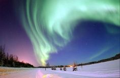 The Aurora Borealis (Northern Lights) shines above Bear Lake, Alaska.