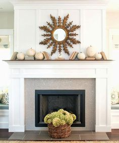 Mantle styling - Fall Mantle - white pumpkins, books, basket of hydrangeas - by Lindsay Hill Interiors