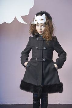 John Galliano kids winter 2013 a classic coat with newsprint detail buttons.