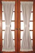 Pull in a narrow rod top and bottom lace door panel to create a good looking hour glass effect.  Perhaps you could use a contrasting color for a tie band.