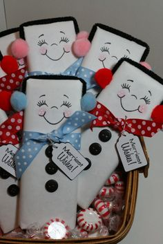Wrap a full sized chocolate bar with white wrapping paper and draw on the faces. For the earmuffs, use a black pipe cleaner and pom poms. Use buttons or black puffy paint and a cute ribbon and tag to complete the look. Really cute idea!!!! black pipe, black puffi, chocol bar, chocolate bars, full size, white wrap, christma, size chocol, pipe cleaner