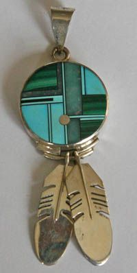 Abstract Zuni sun face pendants with feathers: Duran Gaspar  Materials include: silver, turquoise, variscite, malachite, spiny oyster shell, jet, sugilite, lapis, abalone shell