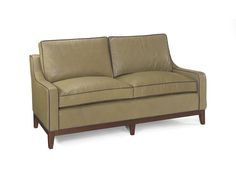 Complete furniture function!  This leather loveseat is all dressed up with contrasting welt to blend perfectly with the wooden base finished in mahogany.  The light mossy green cowhide leather is very popular with today's lifestyles.