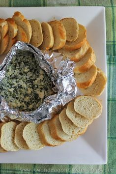 Campfire Spinach Dip.....yummm {1 cup} sour cream {1 pkg} cream cheese {room temperature} 3/4 cup shredded Parmesan cheese 3/4 cup chopped, frozen spinach {drained}